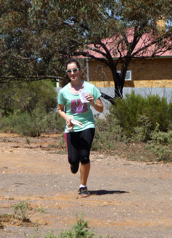 Matilda Sweeney runs in to complete her course 2015